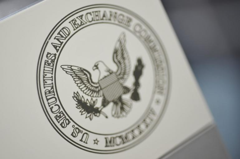 253168-the-u-s-securities-and-exchange-commission-logo-adorns-an-office-door-