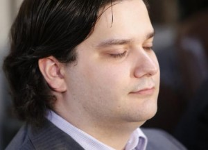 """Mark Karpeles, chief executive of Mt. Gox, attends a news conference at the Tokyo District Court in Tokyo February 28, 2014. Mt. Gox, once the world's biggest bitcoin exchange, filed for bankruptcy protection on Friday, saying it may have lost all of its investors' virtual coins due to hacking into its faulty computer system. Karpeles, bowing in contrition and wearing a suit instead of his customary T-shirt, apologised in Japanese at a news conference for the company's collapse, blaming """"a weakness in our system.""""    REUTERS/Yuya Shino (JAPAN - Tags: CRIME LAW BUSINESS)"""