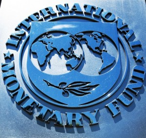 The logo of the International Monetary Fund(IMF) is seen shortly after Christine Lagarde, Managing Director, delivered remarks on the US economy during a press conference June 14, 2013 at IFM headquaraters in Washington, DC.     AFP PHOTO/Paul J. Richards
