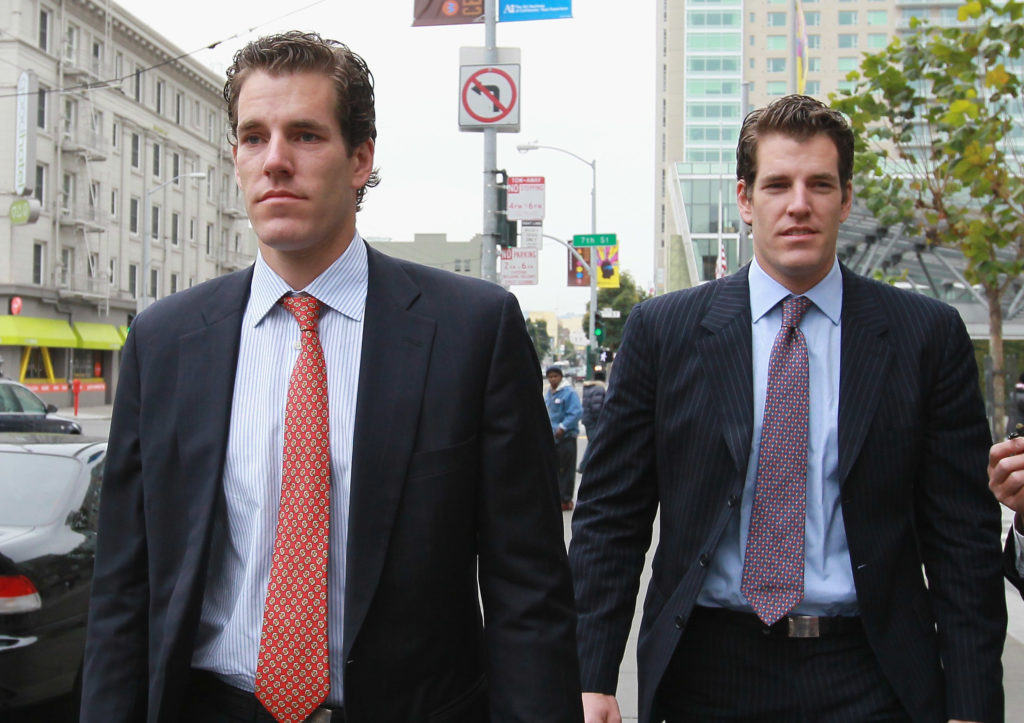 SAN FRANCISCO - JANUARY 11: Cameron (L) and Tyler Winklevoss leave the U.S. Court of Appeals on January 11, 2011 in San Francisco, California. Twin brothers and former Harvard University classmates Cameron and Tyler Winklevoss are requesting that a three-judge panel of the U.S. Court of Appeals in San Francisco to void a 2008 agreement to pay the twins $65 million citing that Facebook did not give an accurate valuation of its shares before agreeing to pay the settlement. (Photo by Justin Sullivan/Getty Images)