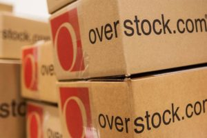 patrick byrne departs but Overstock long on crypto