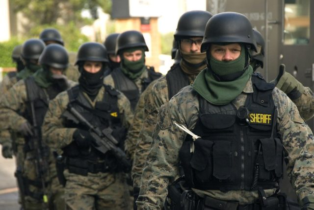 Staring Down a Group of Armed Police