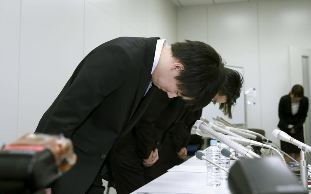 Coincheck executives apologizing for the hack.