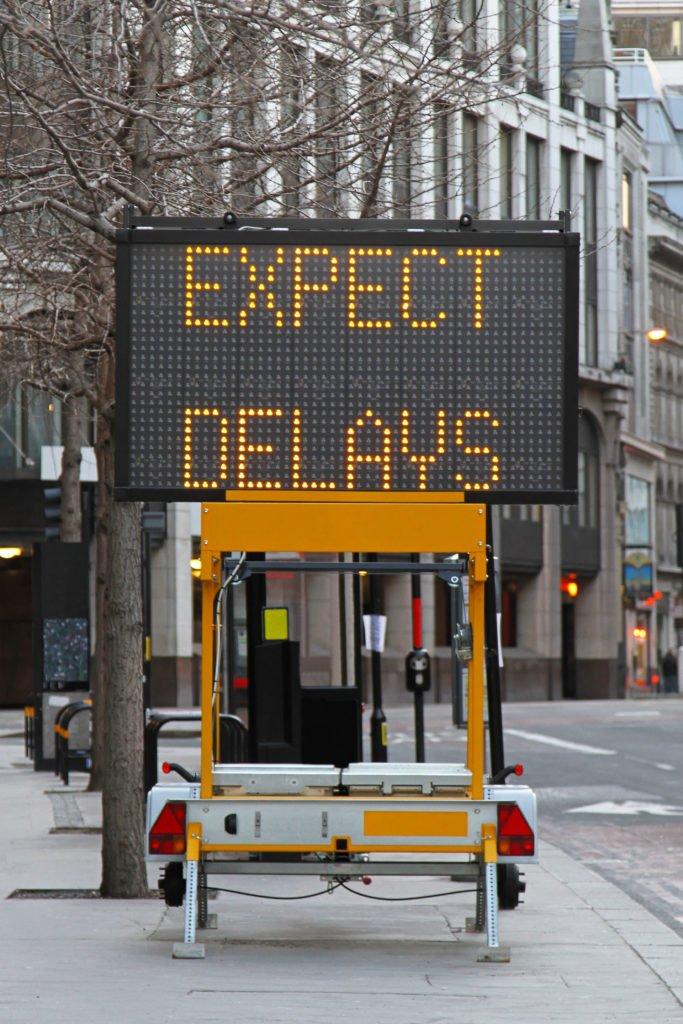 delay street sign