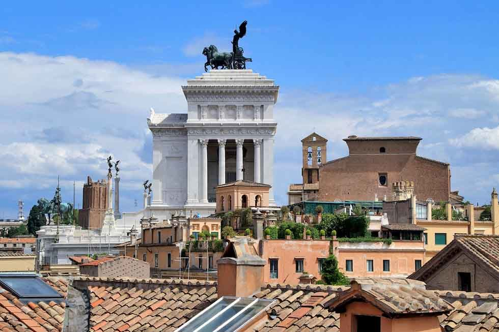 The rooftop terrace provides breathtaking views of the Eternal City.