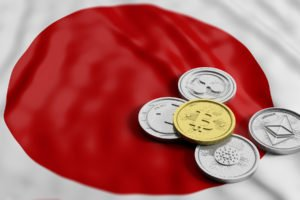 japan flag with crypto tokens