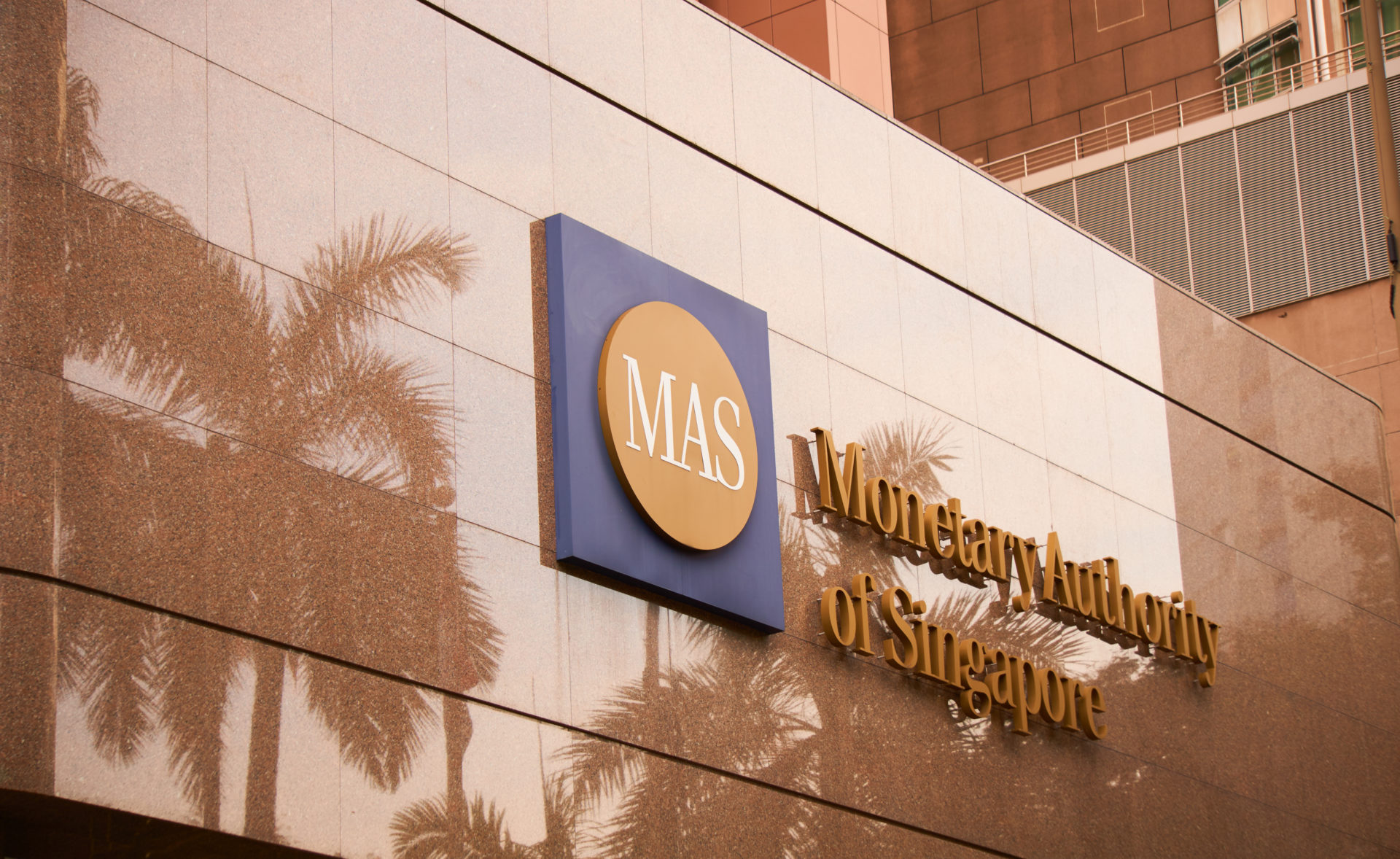 Singapore's Central Bank Partners With Nasdaq, Deloitte on Settling Tokenized Assets