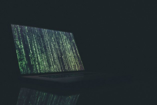 code falling on laptop screen featured image for XRP article