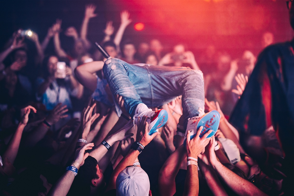 NFT, a person crowdsurfing