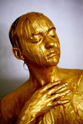 Gold, person bathed in