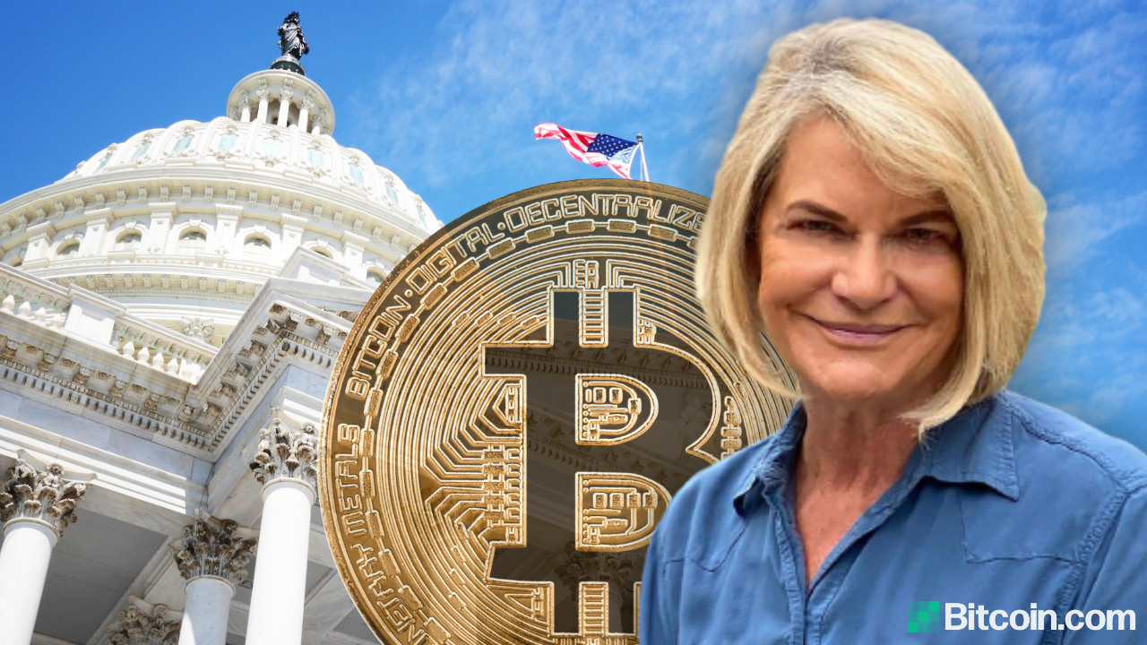 Senator Lummis in front of the Capitol building with a bitcoin behind her