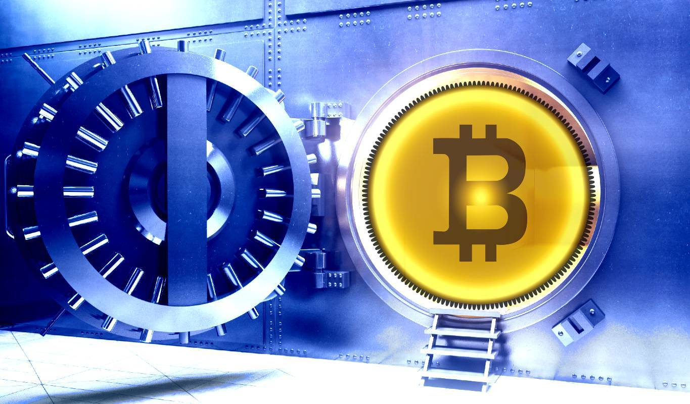 Picture of a bitcoin next to a bank vault