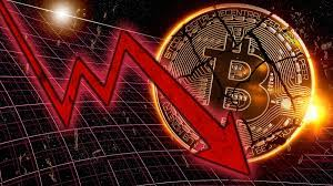 Red downward arrow in front of a bitcoin