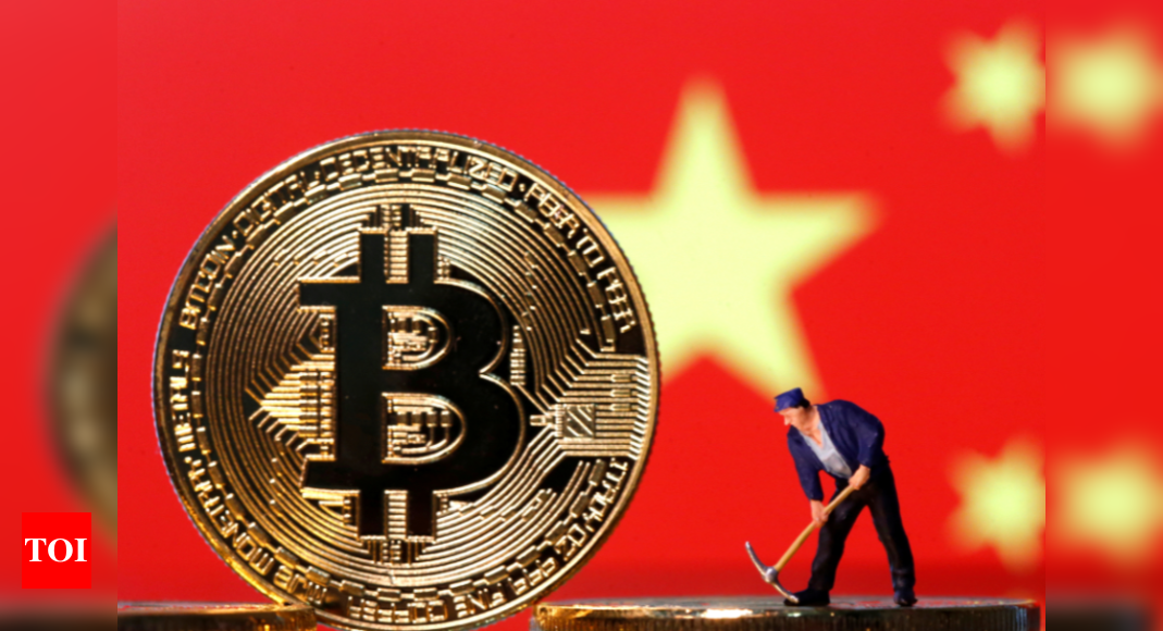 Man with pick axe mining bitcoin. A bitcoin standing in front of the Chinese flag