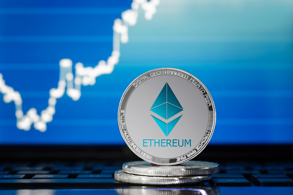 Picture of an ethereum coin with a chart behind it