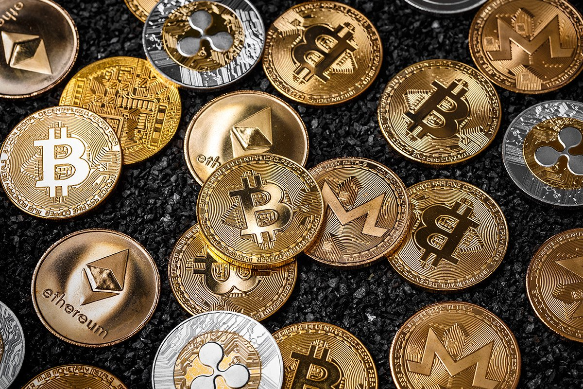 Picture of different crypto coins laying on top each other