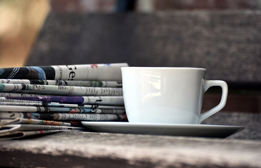 Slate, newspapers and a cup