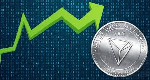 Picture of a Tron coin with a zig zag moving green arrow next to it
