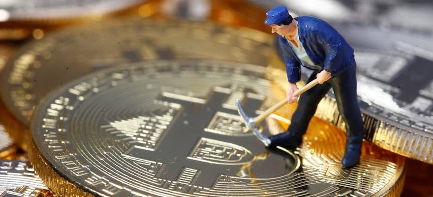 Picture of a figurine with a pick axe mining bitcoin