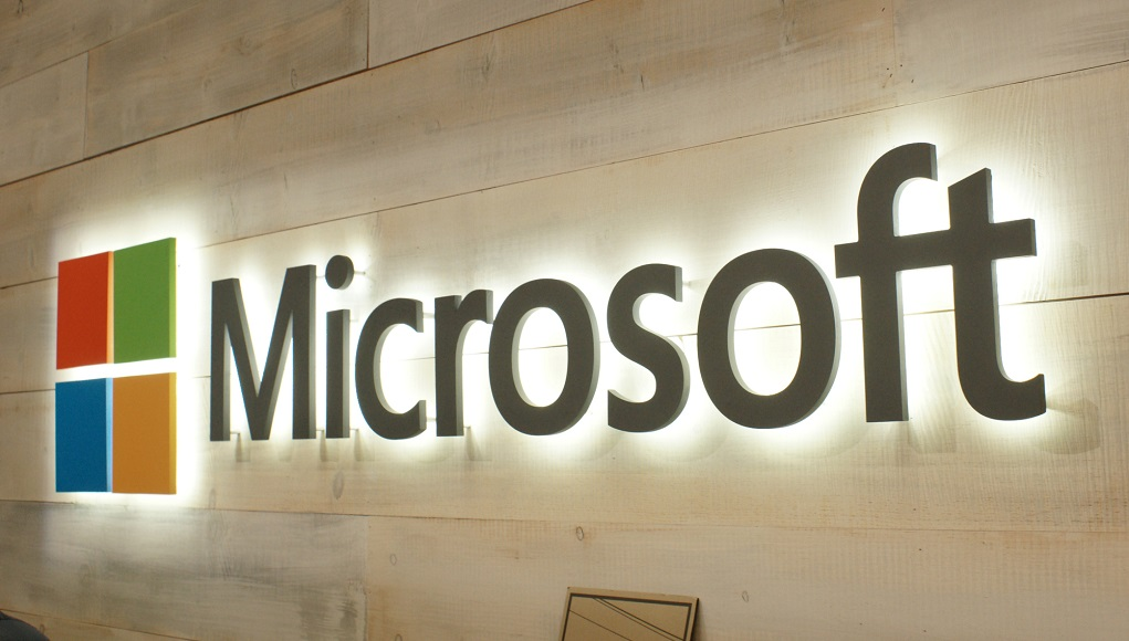 Picture of Microsoft with its logo next to it