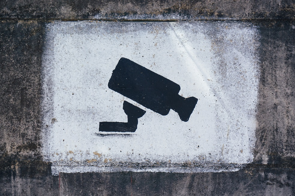 Central Bank, surveillance sign painted on a wall