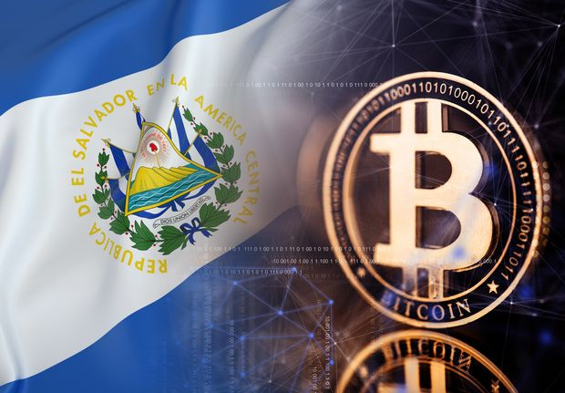 Picture of a bitcoin next to an El Salvador flag