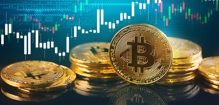 Picture of gold bitcoins in front of a candlestick chart