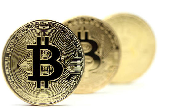 Picture of three bitcoins standing in a row