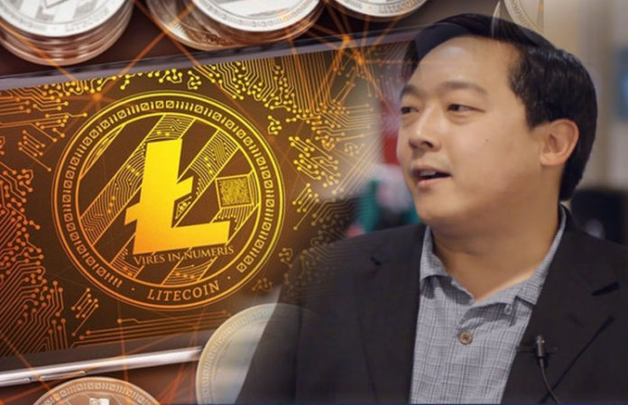 Picture of Litecoin creator Charlie Lee with a gold Litecoin next to him