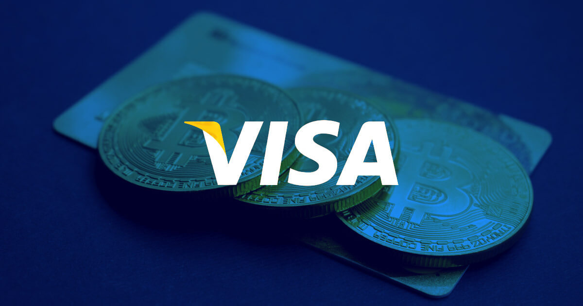 Picture of three bitcoin crypto coins on top of a credit card, with Visa written in front of it