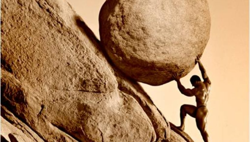 Picture of a man pushing a rock up a mountainside